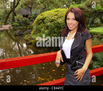 a lovely young lady enjoying the Japanese Tea Garden in Micke Grove Park in Lodi, Claifornia - Stock Photo