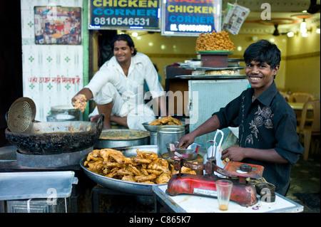 Food on sale at Chicken Corner in Snack market at muslim Meena Bazar, in Old Delhi, India - Stock Photo
