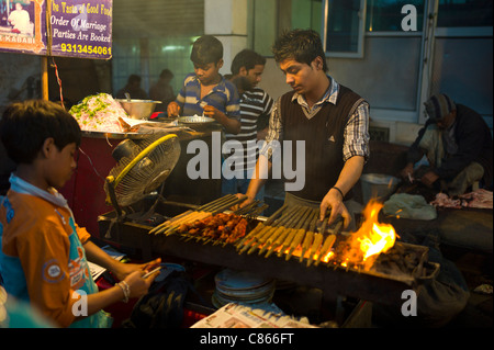 Food, meat kebabs, on sale at meat stall in Snack market at muslim Meena Bazar, in Old Delhi, India - Stock Photo