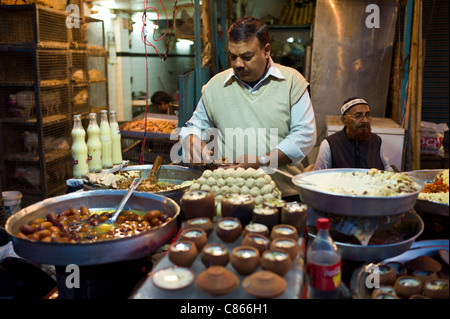 Food on sale at meat stall in Snack market at muslim Meena Bazar, in Old Delhi, India - Stock Photo