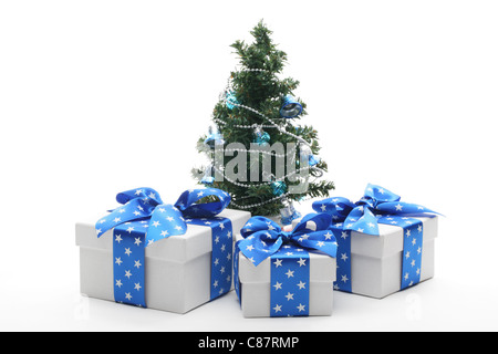 Decorated Christmas tree and gifts,isolated on white. - Stock Photo