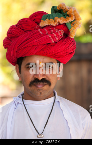 Young Indian man with traditional Rajasthani turban in Narlai village in Rajasthan, Northern India - Stock Photo