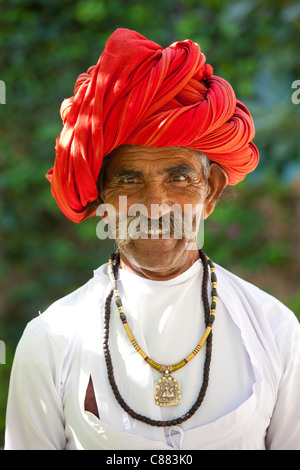 Indian man with traditional Rajasthani turban in Narlai village in Rajasthan, Northern India - Stock Photo