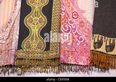 Traditional muslim garments on display at stall in bazaar in Jaipur, Rajasthan, Northern India - Stock Photo
