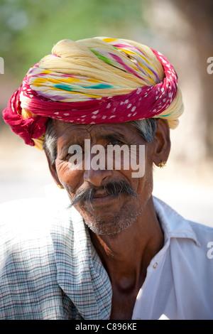 Indian man wears traditional Rajasthani turban in Jaipur, Rajasthan, Northern India - Stock Photo
