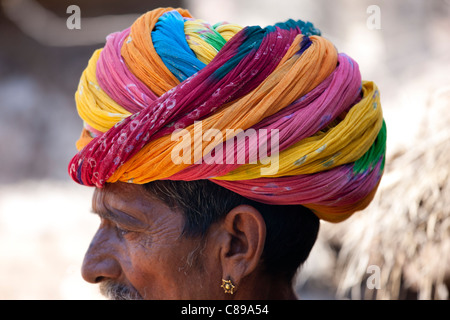 Indian man wearing traditional Rajasthani turban and gold earring in village of Nimaj, Rajasthan, Northern India - Stock Photo