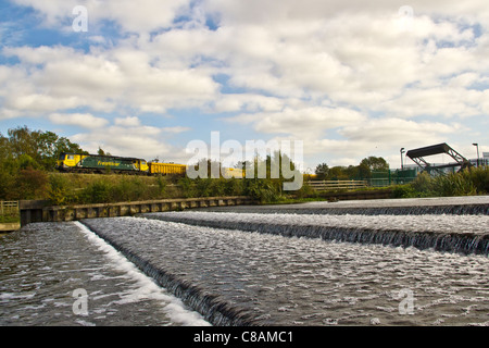 Freightliner Heavy Haul class 70 70006 passes Pillings Lock, Barrow Upon Soar, Leicestershire with a loaded ballast - Stock Photo
