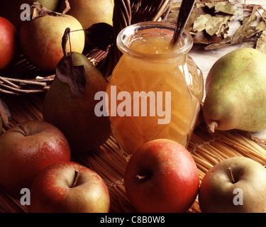 Jar of marmalade with pip fruit - Stock Photo