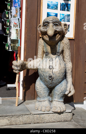Statue of a traditional troll in Norway in front of the shop - Stock Photo