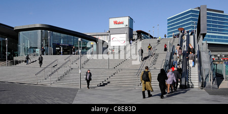 London street scene multicultural people using steps & escalator to Stratford London train station & Westfield shopping - Stock Photo