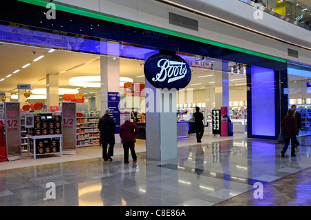 People in Boots pharmacy chemist beauty shop front & shoppers entrance Westfield shopping centre mall in Stratford - Stock Photo
