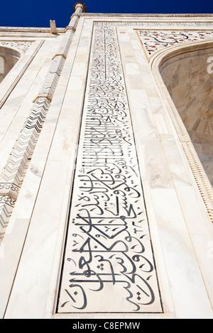 Taj Mahal mausoleum east side calligraphy of teachings from the Koran in Arabic writing on pishtaq arch, Agra, India - Stock Photo