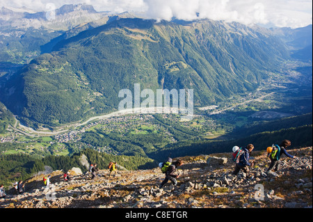 Hikers above Chamonix Valley, Mont Blanc Massif, French Alps, France - Stock Photo