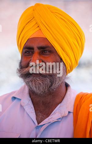Sikh Indian man wearing traditional turban at Bharatpur, Northern India - Stock Photo