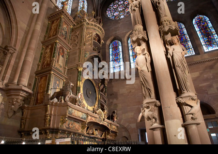 Pillar of Angels, & astronomical clock in south transept of Notre-Dame, UNESCO World Heritage Site, Strasbourg, - Stock Photo