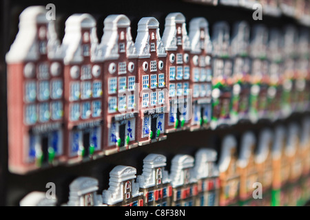 Souvenir fridge magnets in the shape of Amsterdam's Dutch gabled houses, Amsterdam, Netherlands - Stock Photo