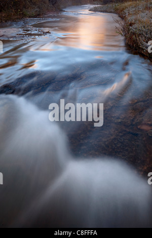 Cascade on Calf Creek on a fall morning, Grand Staircase-Escalante National Monument, Utah, United States of America - Stock Photo