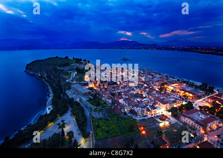 Panoramic view of Nafplio town and the Argolic gulf from Palamidi Castle, in the 'blue' hour. Peloponnese, Greece - Stock Photo