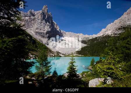 Glacial Sorapiss Lake and God's Finger mountain in the background, Dolomites, eastern Alps, Veneto, Italy - Stock Photo