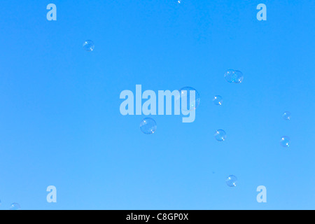 Bubble, Blister, flight, sky, circle, ring, ease, air, rainbow colors, soap, soap bubble, soap bubbles, play, game, - Stock Photo