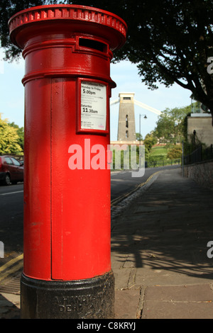 Red Pillar box in foreground 'clifton suspension bridge', bristol in the background - Stock Photo