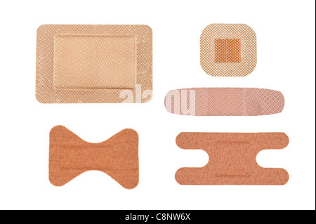 An assortment sterile of adhesive bandages isolated on white - Stock Photo