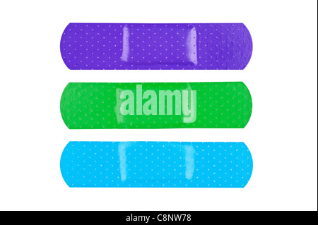 Three colorful adhesive bandages isolated on white - Stock Photo