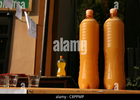 Bottles of young wine known as federweisser or burcak at the annual wine festival Vinobrani at Karlstejn castle, - Stock Photo