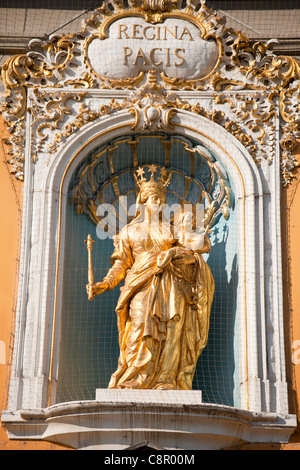 golden Statue of Regina Pacis- Maria with child at the facade of Kurfuerstliches Schloss in Bonn, Germany - Stock Photo