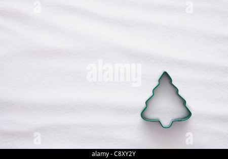 Pastry cutter in christmas tree shape against white backgrounds - Stock Photo