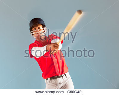 Baseball player swinging bat - Stock Photo