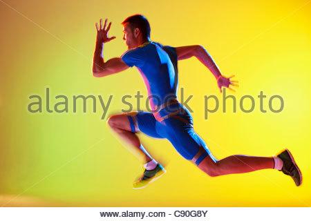 Blurred view of athlete running - Stock Photo