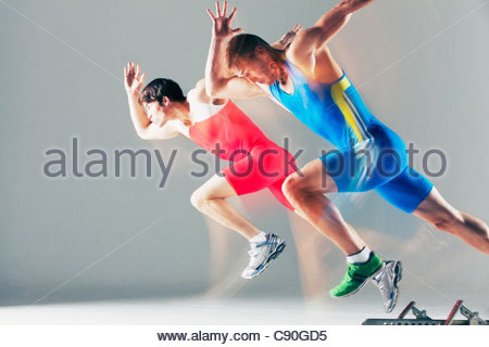 Blurred view of athletes running - Stock Photo