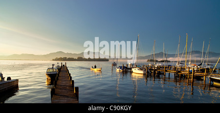 Morning mood in Gstadt with a view on Fraueninsel, Chiemsee, Chiemgau, Upper Bavaria, Bavaria, Germany - Stock Photo