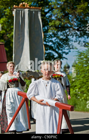 Girl in a white robe, Corpus Christi procession, Benediktbeuern, Alpine foreland, Upper Bavaria, Bavaria, Germany - Stock Photo