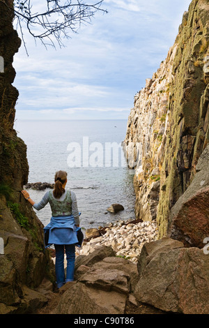 Woman at the cliffs of Jons Kapel, Bornholm, Denmark, Europe - Stock Photo