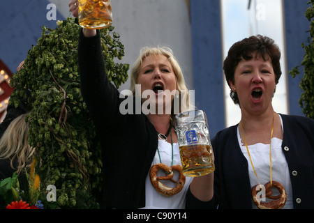 Women enjoy the opening ceremony of the Oktoberfest Beer Festival in Munich, Germany. - Stock Photo