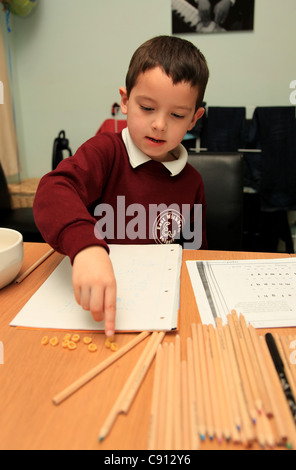Young schoolboy doing his homework. - Stock Photo
