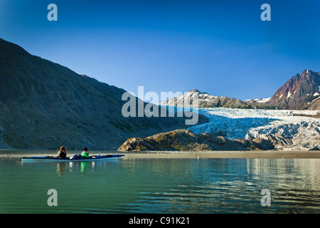 Sea Kayakers paddling to Riggs Glacier in Muir Inlet, Glacier Bay National Park & Preserve, Southeast Alaska, Summer - Stock Photo