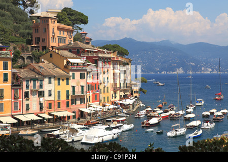 View on famous town of Portofino with small bay full of yachts and boats on Ligurian sea, northern Italy. - Stock Photo