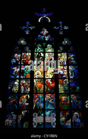 Stained glass window by Alfons Mucha in St Vitus Cathedral at the Prague Castle in Prague, Czech Republic. - Stock Photo