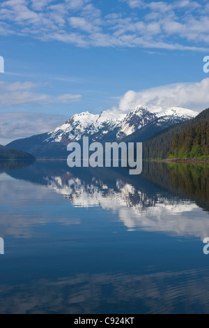 Clouds reflected in the calm waters of Seymour Canal, Admiralty Island, Tongass National Forest, Alaska, Windfall - Stock Photo
