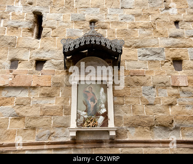 The town of Lucca in Northern Tuscany has many outdoor shrines to the Virgin Mary denoting the town's stong Catholic - Stock Photo