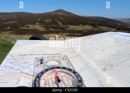 A map and compass in the Lake District - Stock Photo
