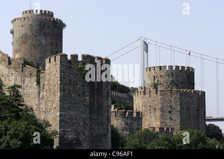 Rumelihisari castle and Bosphorus Fatih Sultan Mehmed bridge in Istanbul, Turkey - Stock Photo