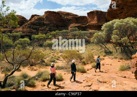Tourists on the Kings Canyon walk. Watarrka (Kings Canyon) National Park, Northern Territory, Australia - Stock Photo