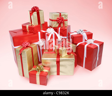 Pile of Christmas gift boxes isolated on pink background with clipping path - Stock Photo