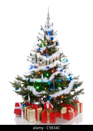 Decorated Christmas tree with gifts under it. Isolated on white background. - Stock Photo