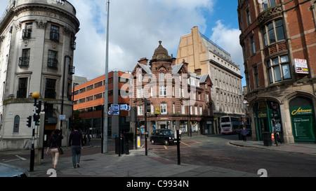 Pedestrians walking along a Manchester street England UK - Stock Photo
