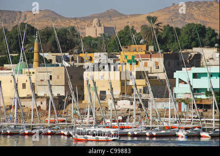 ASWAN, EGYPT. A view of Elephantine Island, with feluccas moored along the banks of the River Nile. 2009. - Stock Photo